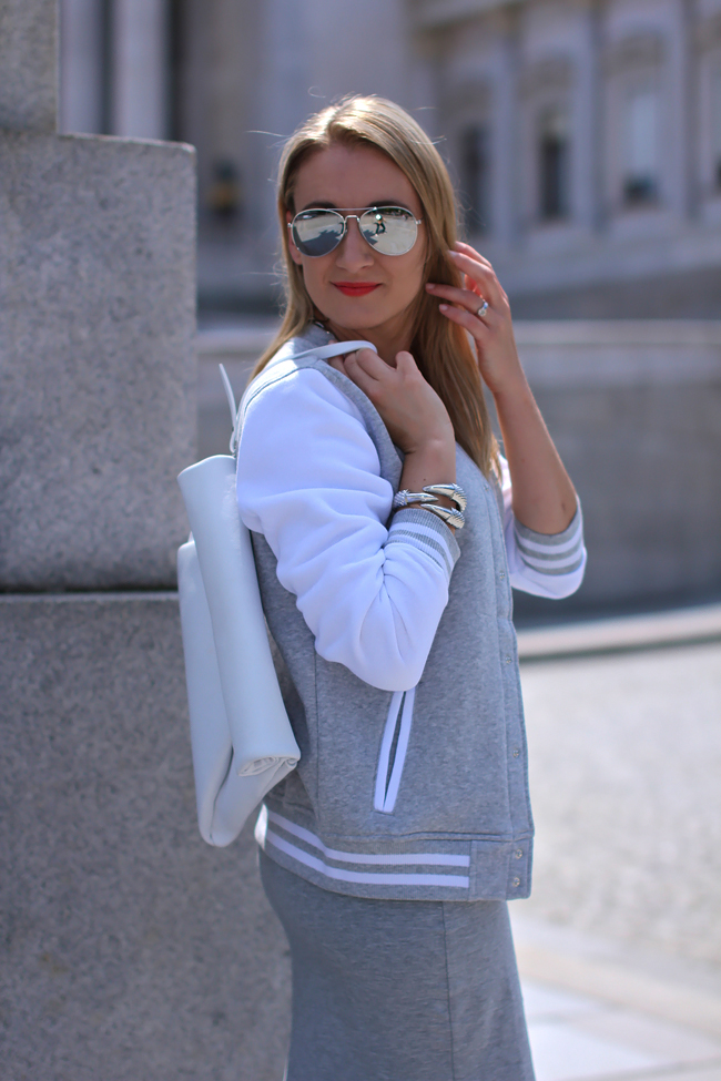 grey tube dress - Mango / college jacket - H&M kids / white leather clutch - Zara / white leather heels - Buffalo / silver chain necklace & mirrored sunglasses - H&M / silver bracelet - LookbookStore / collectedbykatja / collected by Katja / fashion trend 2013 / Modeblog Österreich / fashion blog Austria